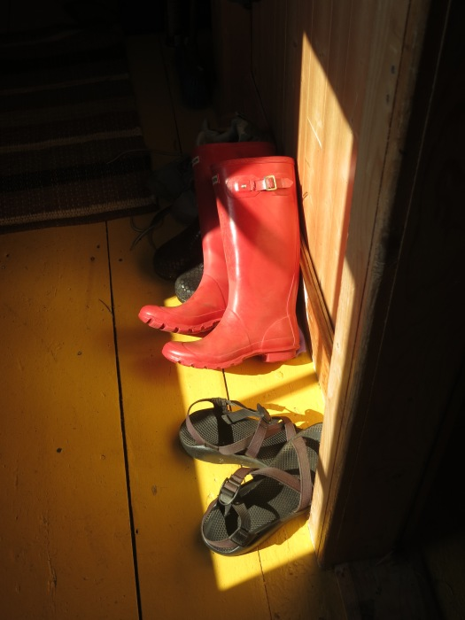 """The much talked-about """"red boots"""" left behind by a previous resident of the Reardon House, Tilting, NF. © Melissa M. Hamel"""